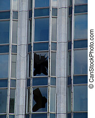 Broken window - A broken window in an office building