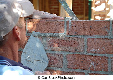 bricklayer budiling a wall