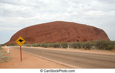 Ayers Rock - The famous Ayers Rock or Uluru in the middle of...