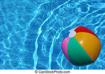 Beach Ball in Pool - Bright beach ball in blue pool