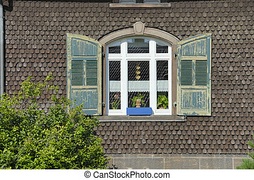 Wooden Window - An white-frame window with gray-green...