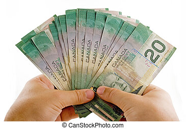Hands with canadian dollars isolated on a white background