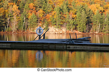 Fall reflections - Autumn Lake reflection with a dock