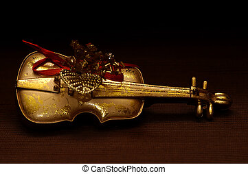Golden Violin - Golden violin on dark background