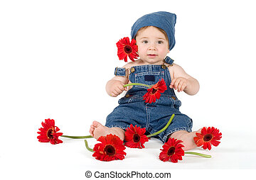 Flower Girl - Young girl sitting on a floor and playing with...