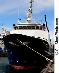Ship Alongside - Fishing vessel tied up at quayside