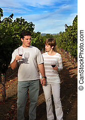 Couple at vineyard - Wine tasting at Napa valley, California