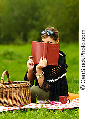 Woman on Picnic - Young business woman with book during...