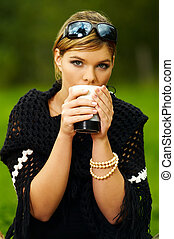 Woman on Picnic - Young business woman with cup during...