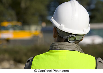 On Site - A construction worker on site and dressed in...