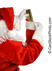 Stocking Stuffer - Santa Claus stuffing a gift into a...