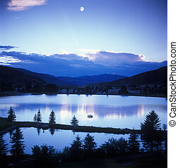 Mountain sunset/moon - Looking across Vail Valley, the moon...