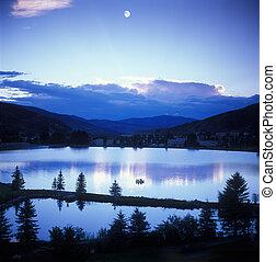 Mountain sunset/moon - Looking across Vail Valley, the moon...