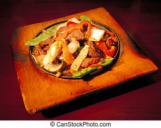 Asian Stir Fry - asian stir fry dish on sizzling hotplate