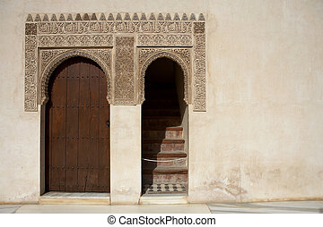 doorway and islamic detail which reads there is no conqueror...