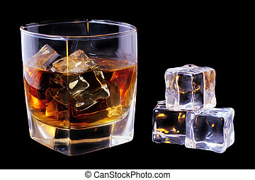 Whiskey and Ice - Whiskey in tumbler and ice cubes over...