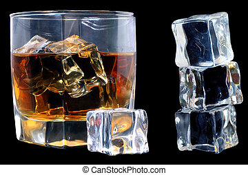 Whiskey and Ice - Whiskey in tumbler with ice cubes over...