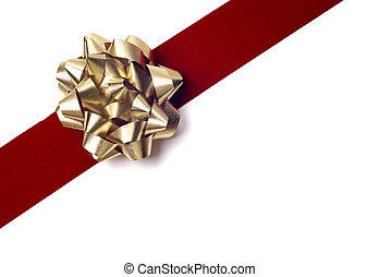 Gift Wrapping - Gold bow on red ribbon isolated against...