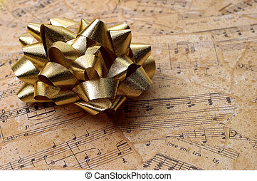 Music Gift Wrapping - Golden bow on gift wrapping...