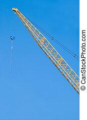 Construction Crane - Idle construction crane against a blue...