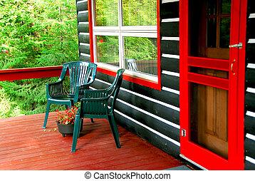 Log cabin deck - Deck of a log cottage in pine forest
