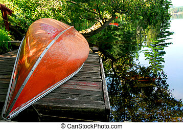 Canoe lake - Canoe on wooden dock on a lake
