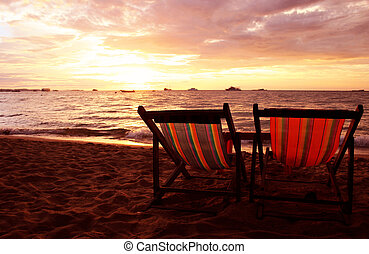Deckchairs at Sunset - Two deckchairs on beach at sunset