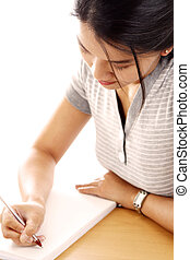 Young woman - A young woman writing on paper