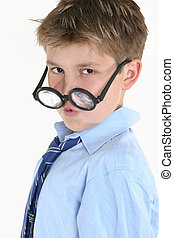 Child looking over top of round glasses - Child looking over...