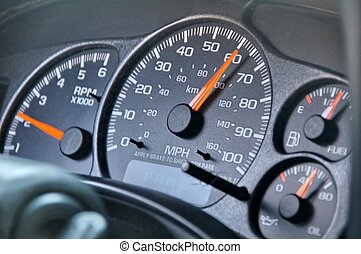 Speedometer - black dashboard on inside of truck