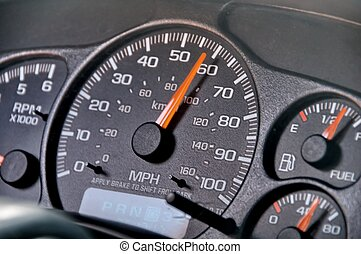 Sixty Miles Per Hour - black dashboard and speedometer