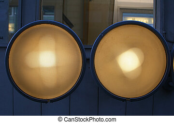 outdoor lights  - two outdoor lights on the side of a boat