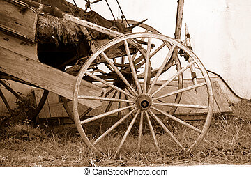 Wagon Wheel - Photo of a Vintage Wooden Wagon Wheel in Sepia...