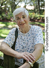 Happy Senior Lady - A pretty, silver haired lady in her...