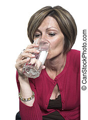 woman drinking water over white background