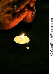 praying over a candle