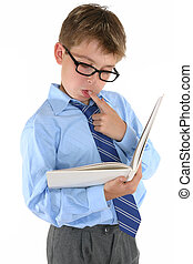 Reading and thinking - A child reading a book and thinking...