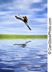 summer jump - happy young man with reflection