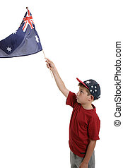 Child waving Australian flag - Patriotic child waving the...