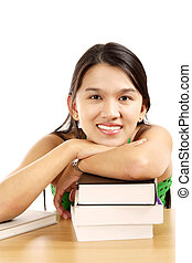 Busy woman - A pretty young woman with a stack of books