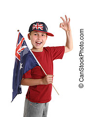 Proudly Australian - A young proud Aussie boy carrying a...
