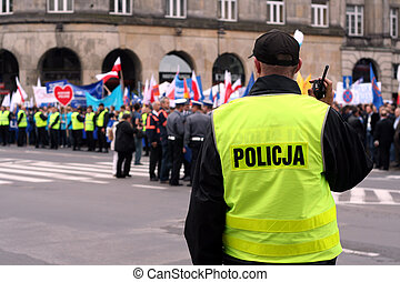 Protecting the demonstration 2 - Police officer talking on a...