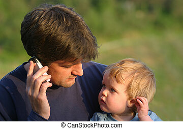 Father to Son Communication - A young son mimics his father...