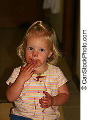 sweet and smudgy - little girl enjoying chocolate