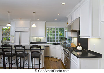 Newly Remodeled White Kitchen - Interior shot of a recently...