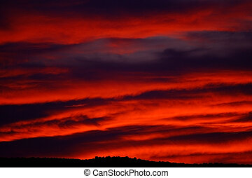 Fiery Sky - Dramatic, fiery sunrise. Could be used as a...