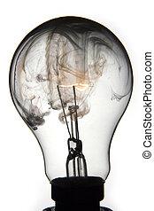 EXPLODING LIGHTBULB - Clear lightbulb explodes on white...