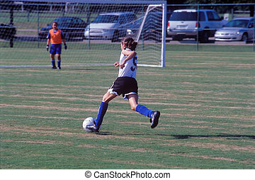 Junior girl soccer - Girl soccer player heading towards the...
