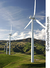 Wind turbines - Wind farm on top of green hills