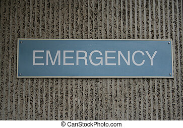 Emergency room sign - blue emergency room sign on concrete...